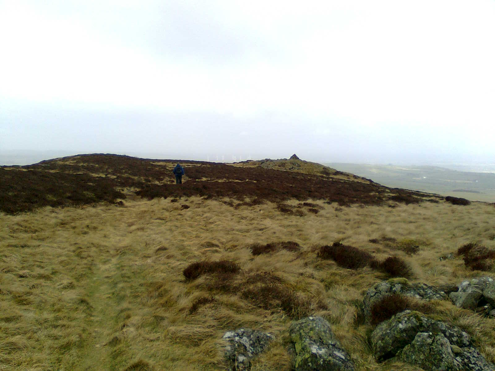 Mick heading for a second summit cairn